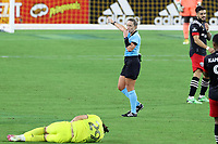 NASHVILLE, TN - SEPTEMBER 23: Referee Tori Penso indicates a foul on Alex Muyl #29 of Nashville SC during a game between D.C. United and Nashville SC at Nissan Stadium on September 23, 2020 in Nashville, Tennessee.