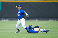 Burlington Royals left fielder Brandon Thomasson (66) throws the ball back to the infield after shortstop Jose Martinez (2) couldn't make the catch during the game against the Danville Braves at Burlington Athletic Park on July 12, 2015 in Burlington, North Carolina.  The Royals defeated the Braves 9-3. (Brian Westerholt/Four Seam Images)
