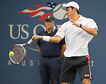 Kei Nishikori (JPN) loses to Marin Cilic (CRO) 6-3, 6-3, 6-3 at the US Open being played at USTA Billie Jean King National Tennis Center in Flushing, NY on September 8, 2014