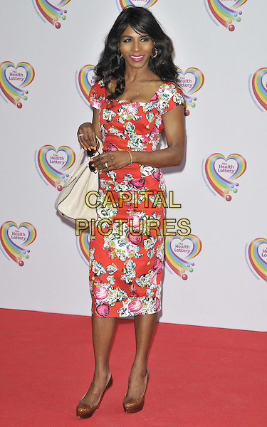 LONDON, ENGLAND - JUNE 02: Sinitta attends the Health Lottery VIP tea party, The Savoy Hotel, The Strand, on Monday June 02, 2014 in London, England, UK.<br /> CAP/CAN<br /> ©Can Nguyen/Capital Pictures