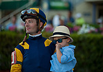 HALLANDALE BEACH, FL - March 3: Julien Leparoux and son watch the replay of his win on Sadler's Joy, owned by Woodslane Farm, in the Grade II Mac Diarmida Stakes at Gulfstream on March 3, 2018 in Hallandale Beach, FL. (Photo by Carson Dennis/Eclipse Sportswire/Getty Images.)