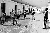 Sudanese children play football at Ktziot prison, August 21, 2007.Sudanese refugees who crossed into Israel illegally are seen in Ktiziot Prison in the Negev Dessert in Israel. About 130 women and children are living in the prison and their future is unclear. Israel said on Sunday it would turn away refugees from Sudan enforcing a policy aimed at halting illegal African migration via Egypt. Photo by Quique Kierszenbaum....