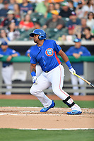Tennessee Smokies first baseman Yasiel Balaguert (12) swings at a pitch during a game against the Biloxi Shuckers at Smokies Stadium on May 26, 2017 in Kodak, Tennessee. The Smokies defeated the Shuckers 3-2. (Tony Farlow/Four Seam Images)