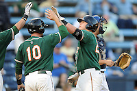 Greensboro Grasshoppers designated hitter Matt Smith #27 is greeted at home after homering during game one of the South Atlantic League, Southern Division playoffs between the Greensboro Grasshoppers and the Asheville Tourists at McCormick Field on September 10, 2012 in Asheville, North Carolina . The Grasshoppers defeated the Tourists 6-3. (Tony Farlow/Four Seam Images).
