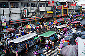 Traffic moves slowly in a busy marketplace fter the rain in Manila, the capital of Philippines. Photo: Sanjit Das