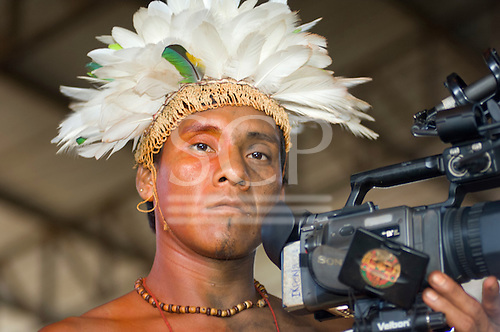 Altamira, Brazil. Encontro Xingu protest meeting about the proposed Belo Monte hydroeletric dam and other dams on the Xingu river and its tributaries. Ikpeng warrior with video camera.