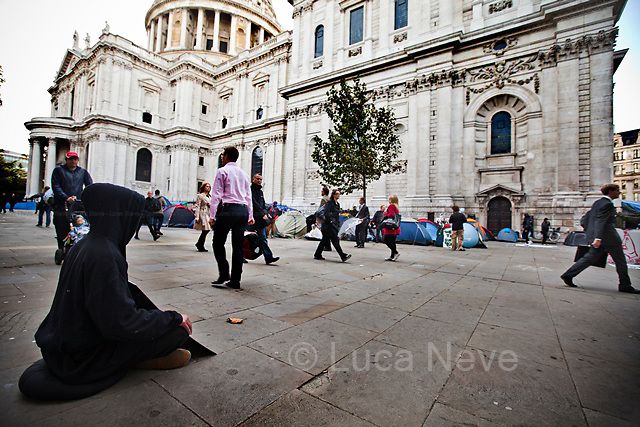 Protester - 2011<br /> <br /> London, 17/10/2011. First working week day after the beginning of the occupation at St Paul's. City workers on their way to their jobs face protesters camped outside St Paul's Cathedral. Life inside the camp is active, creative and full of energy.