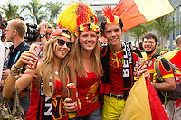 Belgium fans sing and dance in the street outside the Marcana stadium