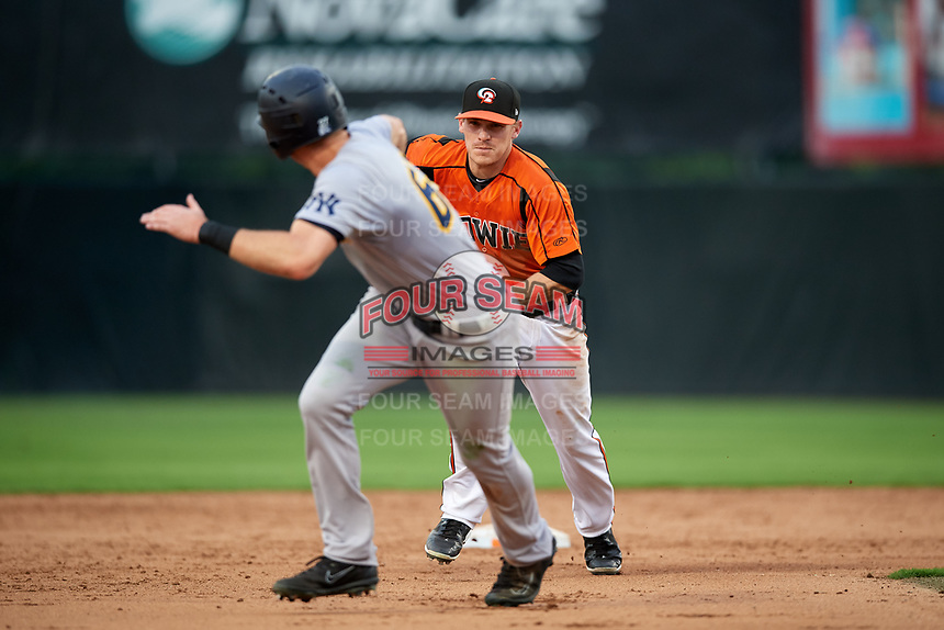 Bowie Baysox second baseman Corban Joseph (5) chases Zack Zehner (63) in a rundown during the first game of a doubleheader against the Trenton Thunder on June 13, 2018 at Prince George's Stadium in Bowie, Maryland.  Trenton defeated Bowie 4-3.  (Mike Janes/Four Seam Images)