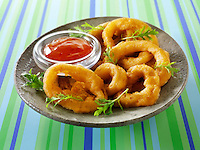 Deep Fried battered onion rings with a chilli sauce & salad