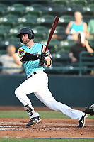 Ryan Anderson (6) of Las Llamas de Hickory follows through on his swing during a game against Los Rapidos de Kannapolis at L.P. Frans Stadium on July 17, 2019 in Hickory, North Carolina. The Llamas defeated the Rapidos 7-5. (Tracy Proffitt/Four Seam Images)