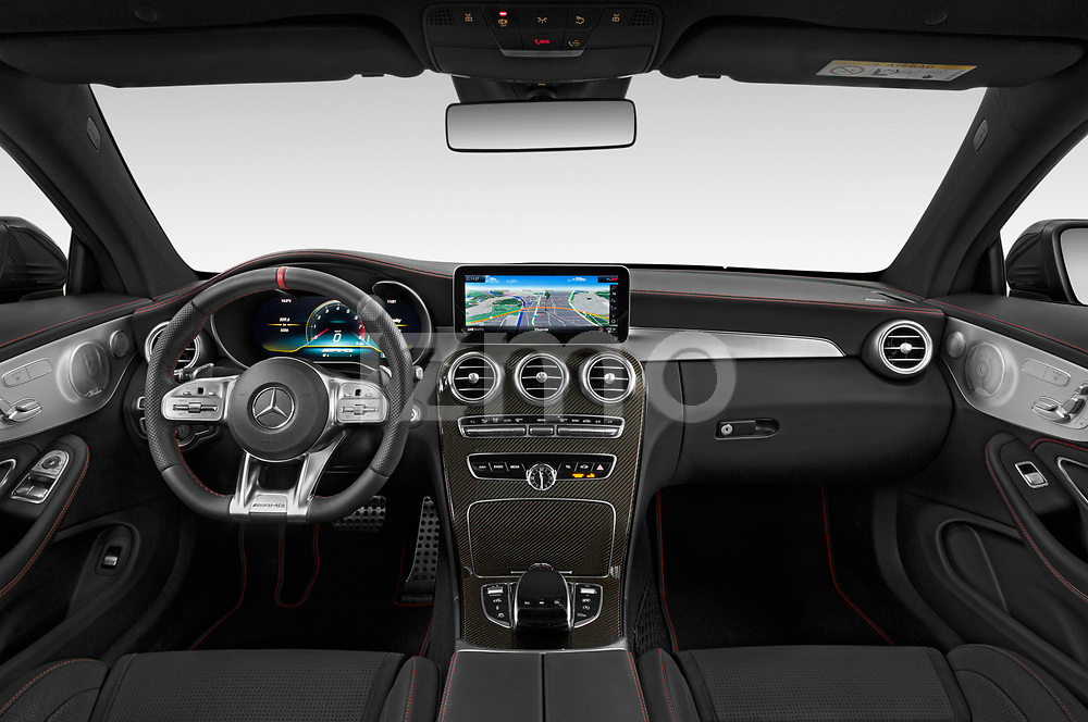 Stock photo of straight dashboard view of a 2020 Mercedes Benz C class 43-AMG 2 Door Coupe