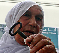 """Gaza.15.05.2008.Palestinian refugee Um Jaber Wishah 78 years, who now lives in Burije refugee camp 15,May, 2008. While the Israelis are celebrating the 60th anniversary of the birth of their nation, Palestinians are marking the Nakba, (literally """"Catastrophe""""), of the expulsion of more than 700,000 from homes as fighting raged at Israel's founding in 1948.""""photo by Fady Adwan"""""""