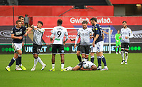 3rd October 2020; Liberty Stadium, Swansea, Glamorgan, Wales; English Football League Championship, Swansea City versus Millwall; Tempers flare as Andre Ayew of Swansea City lies on the floor holding his face