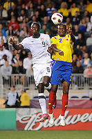 Eddie Johnson (9) of the United States (USA) and Aquivaldo Mosquera (2) of Colombia (COL) go up for a header. The men's national teams of the United States (USA) and Colombia (COL) played to a 0-0 tie during an international friendly at PPL Park in Chester, PA, on October 12, 2010.