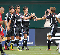 DC United midfielder Ben Olsen (14) celebrates with Brian Carroll (16), Jaime Moreno (99) and Christian Gomez (10) his first goal of the game in the 15th minute. Olsen scored the first hat trick of his career against Red Bull NY. DC United defeated the New York Red Bulls 4-2, at RFK Stadium in Washington DC, Sunday June 10, 2007.