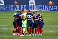 CHICAGO, UNITED STATES - AUGUST 25: Chicago Fire starting XI huddle during a game between FC Cincinnati and Chicago Fire at Soldier Field on August 25, 2020 in Chicago, Illinois.