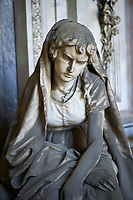 Picture and image of the stone sculpture of a young women grieving in the Borgosie Realistic style. The Gatti Tomb sculpted by G Benetti 1875. Section D no 5, the monumental tombs of the Staglieno Monumental Cemetery, Genoa, Italy