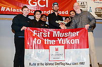The Lakefront Anchorage First Musher to the Yukon Award is<br /> Presented  by Greg Beltz, general manager of The Lakefront Anchorage to Nicolas Petit at the Nome Musher's Award Banquet during the 2017 Iditarod on Sunday March 19, 2017.<br /> <br /> Photo by Jeff Schultz/SchultzPhoto.com  (C) 2017  ALL RIGHTS RESERVED