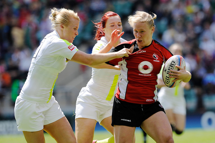 Mandy Marchak of Canada is tackled by Michaela Staniford (left) and Joanne Watmore of England during the iRB Challenge Cup at Twickenham on Sunday 13th May 2012 (Photo by Rob Munro)