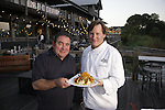 Chef Emeril Lagasse poses with co-owner Chef Jim Shirley and his Grits a Yaya at the Fish House on South Barracks St. in Pensacola, FL as seen on Cooking Channel's Emeril's Florida, Season 1.