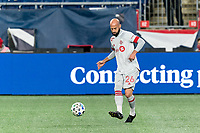 FOXBOROUGH, MA - OCTOBER 7: Laurent Ciman #26 of Toronto FC passes the ball during a game between Toronto FC and New England Revolution at Gillette Stadium on October 7, 2020 in Foxborough, Massachusetts.
