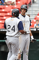Charlotte Knights outfielder Jordan Danks #15 greets Dayan Viciedo #24 after a home run during a game against the Buffalo Bisons at Dunn Tire Park on May 22, 2011 in Buffalo, New York.  Buffalo defeated Charlotte by the score of 7-5.  Photo By Mike Janes/Four Seam Images