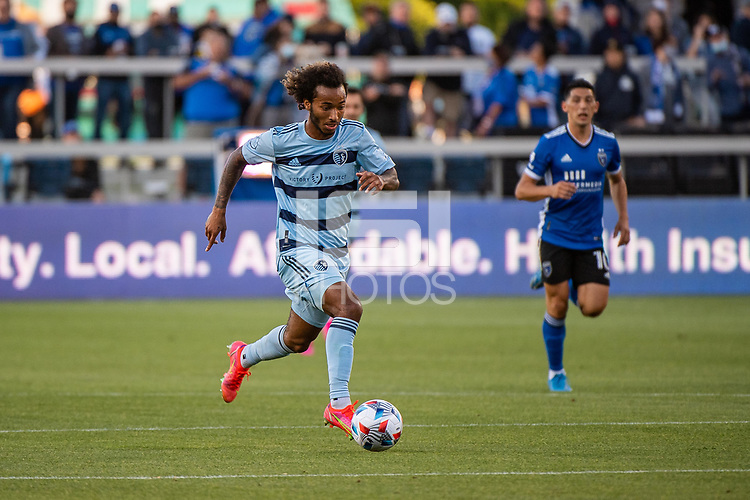 SAN JOSE, CA - MAY 22: Gianluca Busio #10 of Sporting Kansas City dribbles the ball during a game between San Jose Earthquakes and Sporting Kansas City at PayPal Park on May 22, 2021 in San Jose, California.