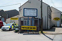 Monday 19 June 2017<br /> Pictured: Police at the entrance to the Pontyclun hire firm <br /> Re: The van which was driven by Darren Osborne into worshippers near a north London mosque was hired by a firm in south Wales. One man has died and 10 people have been injured after a van mounted a pavement near Finsbury Park Mosque.Forensics officers are examining a white van which has Pontyclun Van Hire on it.