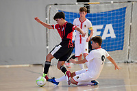 Astor Perez Baldoni of Selwyn College and Torhan Kurnaz of Hamilton Boys' High School battle for the ball during the Futsal NZ Secondary Schools Junior Boys Final between Hamilton Boys High School and Selwyn College at ASB Sports Centre, Wellington on 26 March 2021.<br /> Copyright photo: Masanori Udagawa /  www.photosport.nz