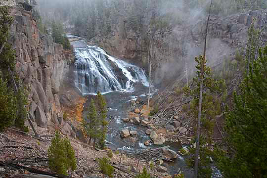 Fall fog at Gibbon Falls. This fall is an 84 foot waterfall on the Gibbon River, about five miles northeast of Madison Junction on the lower loop of the Grand Loop road in west central Yellowstone National Park.