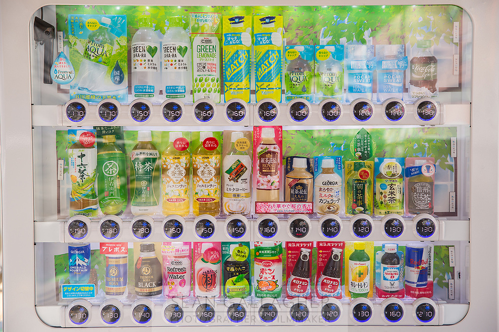 A colorful vending machine selling different types of drinks.