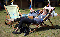 HOT AND SUNNY WEATHER PICTURE WALES<br />Hay on Wye. Friday 03 June 2016<br />A woman rests on the festival green at the Hay Festival, Hay on Wye, Wales, UK