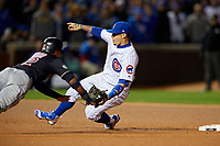 Chicago Cubs second baseman Javier Baez (9) fields a throw down to catch Francisco Lindor (12) attempting to steal second in the sixth inning during Game 5 of the Major League Baseball World Series against the Cleveland Indians on October 30, 2016 at Wrigley Field in Chicago, Illinois.  (Mike Janes/Four Seam Images)
