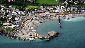 The old harbour at Greystones – the circular end to the main pier was salvaged from the failed first attempt at pre-fabricating the Kish Lighthouse.
