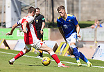 St Johnstone v Fleetwood Town…24.07.21  McDiarmid Park<br />Reece Devine is tackled by Jordan Rossiter<br />Picture by Graeme Hart.<br />Copyright Perthshire Picture Agency<br />Tel: 01738 623350  Mobile: 07990 594431