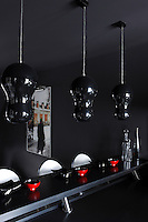 The decorative theme in this contemporary kitchen is black on black