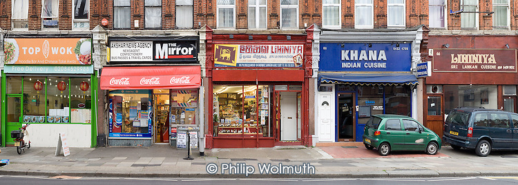 Shops and restaurants of various nationalities on Cricklewood Broadway, London.