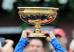 09 August 29: Jockry Kent Desormeaux holds the Travers trophy high above his head after Summer Bird, trained by Tim Ice, wins the 140th running of the grade 1Travers Stakes for three year olds at Saratoga Race Track in Saratoga Springs, New York.