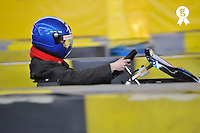 Boy (15) driving a go-cart on a race track (Licence this image exclusively with Getty: http://www.gettyimages.com/detail/85985799 )