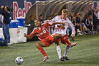 Toronto FC midfielder Amado Guevara (20) is fouled by New York Red Bulls defender Chris Leitch (33) during a Major League Soccer match at Giants Stadium in East Rutherford, NJ, on October 04, 2008. Photo by Howard C. Smith/isiphotos.com