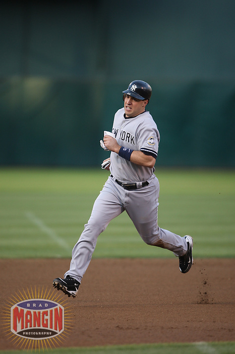 OAKLAND, CA - AUGUST 17:  Mark Teixeira #25 of the New York Yankees runs the bases against the Oakland Athletics during the game at the Oakland-Alameda County Coliseum on August 17, 2009 in Oakland, California. Photo by Brad Mangin