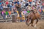 Ryan McKenzie hops off his bucking saddle bronc--saddle bronc riding, Jordan Valley Big Loop Rodeo, Ore...