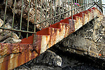 Stairs up from the beach of Camogli to the boardwalk with a coat of paint in nearly the same color like rust.