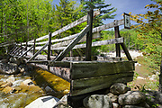 Side view of the Thoreau Falls Trail bridge in the Pemigewasset Wilderness of New Hampshire. This wooden bridge, at North Fork junction, crosses the East Branch of the Pemigewasset River.