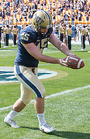 Pitt punter Nick Goldsmith warms up before the game. Iowa Hawkeyes defeated the Pitt Panthers 24-20 at Heinz Field, Pittsburgh Pennsylvania on September 20, 2014.