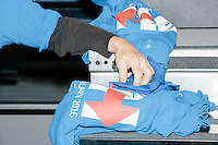 A campaign volunteer hands out t-shirts to other campaign volunteers before former Secretary of State and Democratic presidential candidate Hillary Rodham Clinton speaks at a rally at Nashua Community College in Nashua, New Hampshire, on Tues. Feb. 2, 2016. Former president Bill Clinton also spoke at the event. The day before, Hillary Clinton won the Iowa caucus by a small margin over Bernie Sanders.