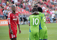 August 10, 2013: Seattle Sounders FC midfielder Mauro Rosales #10 celebrates his goal with Seattle Sounders FC forward Obafemi Martins #9 during an MLS regular season game between the Seattle Sounders and Toronto FC at BMO Field in Toronto, Ontario Canada.<br /> Seattle Sounders FC won 2-1.