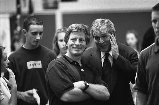 31 Jul 2000, Ohio, USA --- Original caption: George W. Bush talks to Stuart Stevens while watching the RNC from a Westerville, Ohio high school. --- Image by © Brooks Kraft/Sygma/Corbis