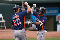 Houston Astros Jeremy Peña (89) celebrates hitting a home run with Steven Souza Jr. (20) during a Major League Spring Training game against the Miami Marlins on March 21, 2021 at Roger Dean Stadium in Jupiter, Florida.  (Mike Janes/Four Seam Images)